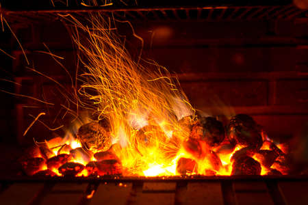 grilled potato: Sparks coming out of a barbecue Stock Photo