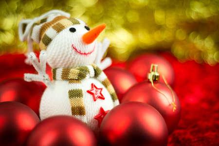 Christmas balls surrounding a wool snowman. Shallow DoF. photo