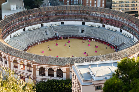 MALAGA, SPAIN - CIRCA SEPTEMBER 2011:  Bullring with people practicing the art of bullfighting circa September 2011 in Malaga, Spain. Stock Photo - 11260252