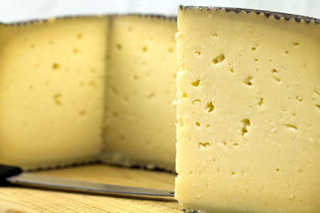 Closeup of a piece of manchego cheese  Stock Photo