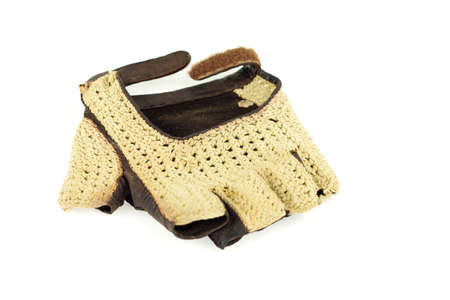 Old retro leather driving fingerless glove isolated on white
