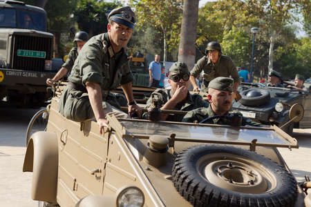 MURCIA, SPAIN - OCTOBER 15:  German soldiers on a car during a military parade. Historical military reenacting on October 15, 2011 in Murcia, Spain. Stock Photo - 11652889