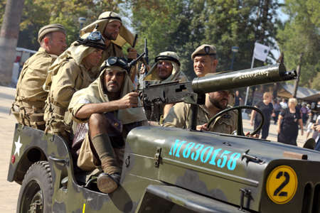 MURCIA, SPAIN - OCTOBER 15:  American soldiers on a car during a military parade. Historical military reenacting on October 15, 2011 in Murcia, Spain. Editorial