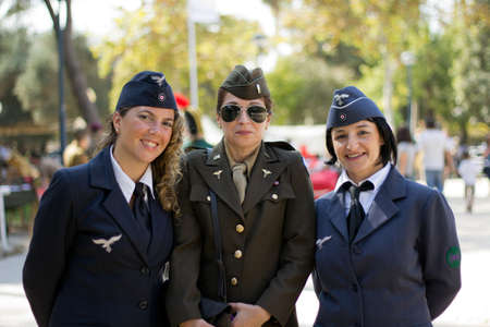 MURCIA, SPAIN - OCTOBER 15:  Soldier girls posing during a military parade. Historical military reenacting on October 15, 2011 in Murcia, Spain. Stock Photo - 11652895