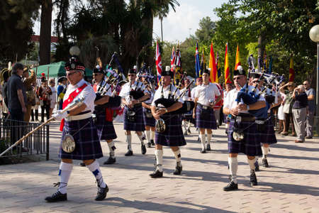 MURCIA, SPAIN - OCTOBER 16: Scottish pipers in a military parade. Historical military reenacting on October 16, 2011 in Murcia, Spain. Editorial