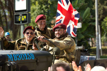 MURCIA, SPAIN - OCTOBER 16: British soldiers on a military vehicle during the Historical Military Reenacting on October 16, 2011 in Murcia, Spain. Stock Photo - 11719585