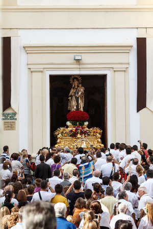 MALAGA, SPAIN - JULY 16: Unidentified local worshippers lift a religious image out of the church during the