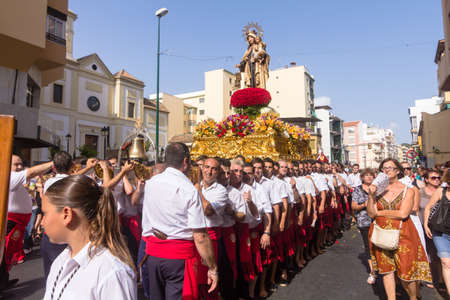 MALAGA, SPAIN - JULY 16: Unidentified local worshippers carry a religious image during the Virgen del Carmen procession on July 16, 2012 in Malaga, Spain. The Virgen del Carmen is the patron saint and protector of fishermen and sailors