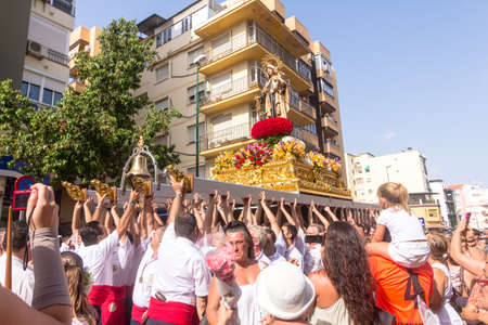 MALAGA, SPAIN - JULY 16: Unidentified local worshippers carry a religious image during the