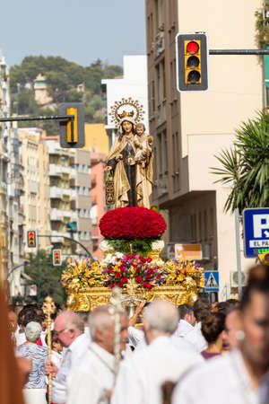 MALAGA, SPAIN - JULY 16: Religious image of Virgen del Carmen is lifted through the city streets during the procession on July 16, 2012 in Malaga, Spain.