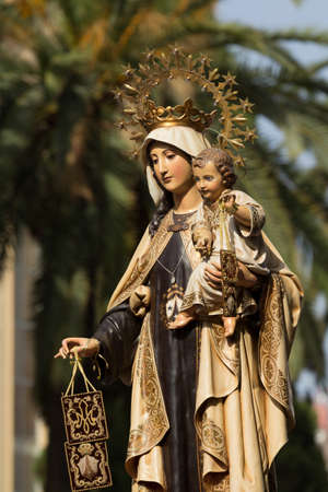 carmen: Religious image of the Virgin during the Virgen del Carmen procession Stock Photo