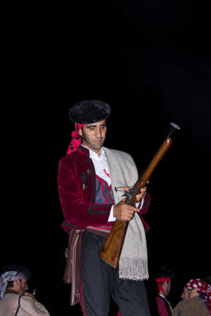 reloading: MALAGA, SPAIN - OCTOBER 13: Unidentified bandit reloading his blunderbuss at Pasion Bandolera reenactment of 1840 Editorial