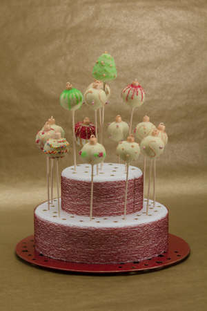 White chocolate Christmas cake pops on brown background photo