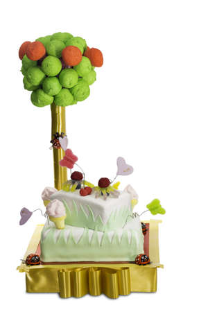 Two tier cake with fondant and gumdrop decoration isolated on white Stock Photo