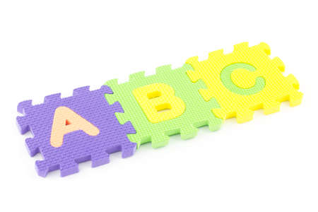 Colored puzzle pieces wit ABC letters isolated on white background photo