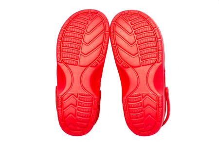 Red rubber shoes on a white background