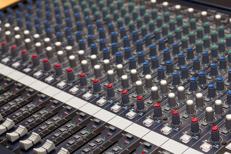 Audio mixing console in a recording studio  Faders and knobs of a sound mixer Stock Photo