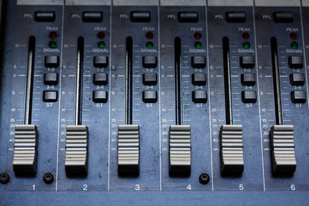 Audio mixing console in a recording studio  Faders of a sound mixer Stock Photo