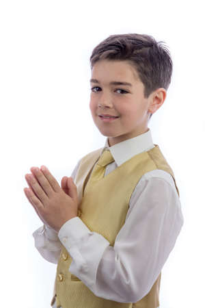 A young boy celebrating his First Holy Communion