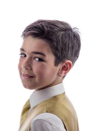 Een jonge jongen viert zijn Eerste Heilige Communie Stockfoto