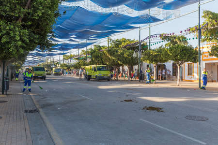MALAGA, SPAIN - AUGUST 21, 2014: Squad cleaning the streets at the august fair of Malaga