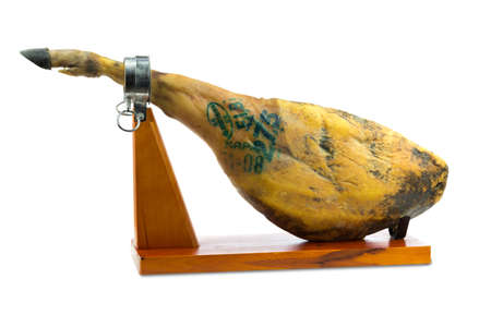 Spanish iberian ham with special green ink of quality controls isolated on white background photo