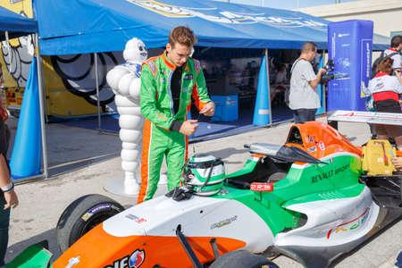 motosport: JEREZ DE LA FRONTERA, SPAIN - OCTOBER 19, 2014: Andrea Pizzitola of Manor MP Motosport Team prepares to drive his car at Jerez racetrack Editorial
