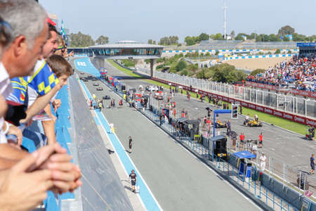 JEREZ DE LA FRONTERA, SPAIN - OCTOBER 19, 2014: Drivers go to their starting possition for the Eurocup Formula Renault 2.0 race at Jerez racetrack Editorial