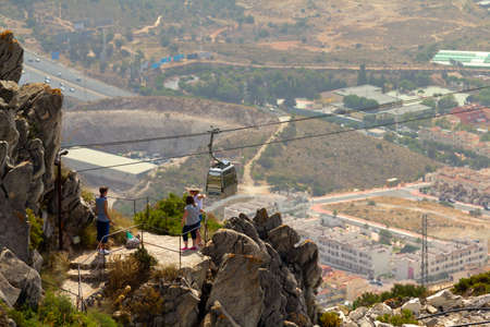 MALAGA, SPAIN - AUGUST 10, 2012: Unidentified tourists hiking in Calamorro mountain. The cableway reach the summit of the Calamorro Mountain, the highest spot in Benalmadena.