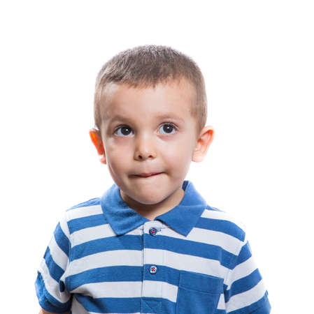 dubious: Portrait of dubious beautiful little boy isolated on white background Stock Photo