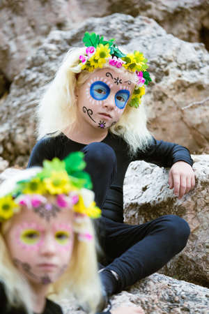 dead woman: Twins with black clothing and sugar skull makeup outdoors