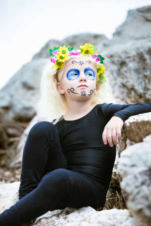 day of the dead: Portrait of a cute girl outdoors with sugar skull makeup Stock Photo