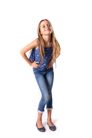 vest in isolated: Cute girl posing in blue jeans and vest isolated on white