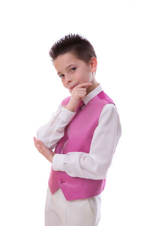 Young boy holding his chin and looking at camera celebrating his First Holy Communion on a white background Stock Photo