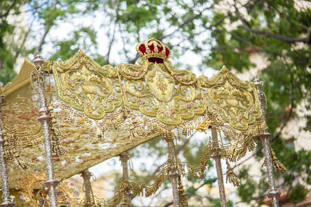 Details of embroidery and tassels in a throne. Holy Week in Spain.