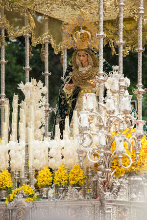 Virgin Mary on palm sunday (easter week). Heavy figure that is moved by manpower during a procession. Typical of Easter, Holy Week in Spain.