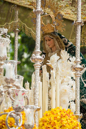 semana santa: Virgin Mary on palm sunday (easter week). Heavy figure that is moved by manpower during a procession. Typical of Easter, Holy Week in Spain.