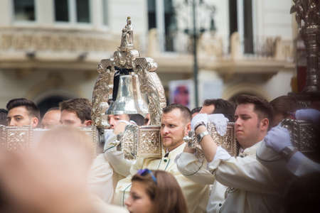 MALAGA, SPAIN - MARCH 20: Bearers participating in the procession of Palm Sunday (Pollinica) on March 20, 2016 in Malaga, Spain.