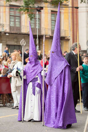 MALAGA, SPAIN - MARCH 20: Nazarenes participating in the procession of Palm Sunday (Pollinica) on March 20, 2016 in Malaga, Spain.
