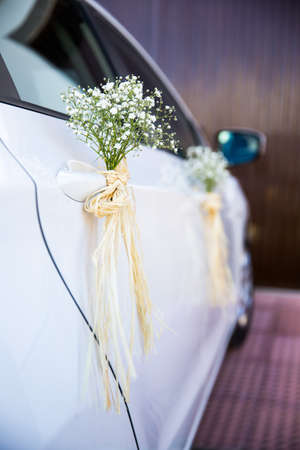 Wedding car decorated with flowers Stock Photo