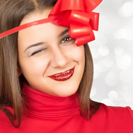 Beautiful woman in red with sparkling lips blinking in camera Stock Photo - 15563324