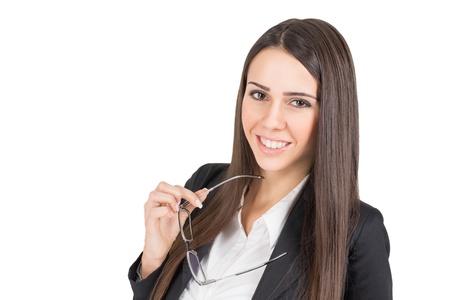 Confident businesswoman holding eyeglasses Stock Photo