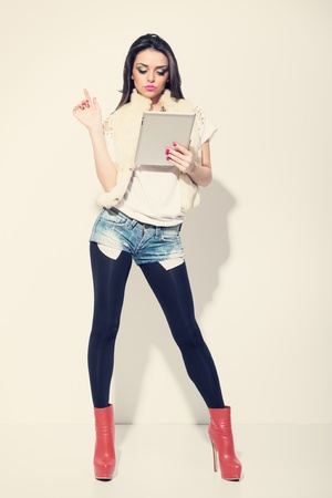 Attractive fashionable woman using tablet pc
