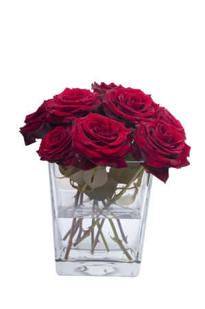Bunch of red rose flowers in a small vase