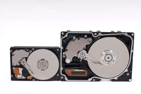 Little and big hard-drives (side by side) Stock Photo