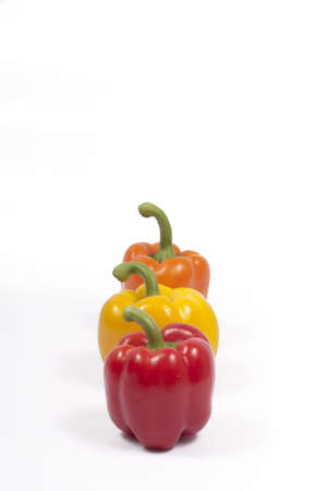 red, yellow and orange capsicums (aligned view)