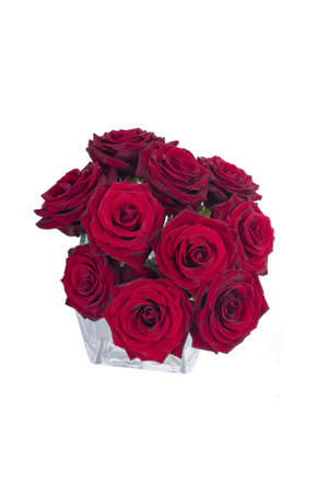 Bunch of red rose flowers in a small vase (top view) Stock Photo