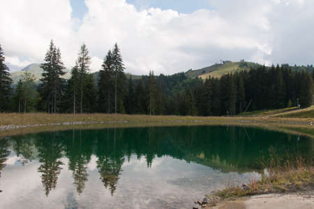 paysage: Altitude lake and the Mont Joly in background Stock Photo