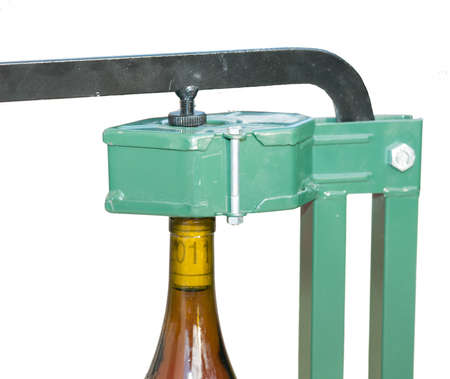 Bottle Capper and wine bottle  closeup view  Stock Photo