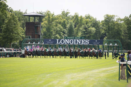 CHATILLY, FRANCE - JUNE 2013: Third Course of the Prize of Diane Longines on June 16, 2013 in Chantilly. Course name: Grand Handicap Longines.